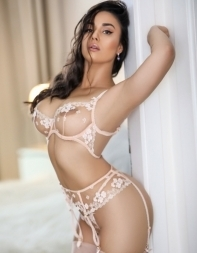 Elite London escort Etta in white lingerie - Brazilian escort in West End, Westminster