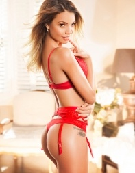 High class escort Mandy is sexy and seductive in her naughty red lingerie. - European escort in Mayfair, Park Lane