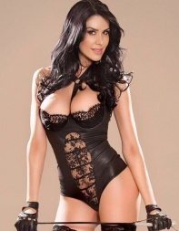 High end escort Latoya in black lingerie holding a whip - Brazilian escort in Central London, Marylebone