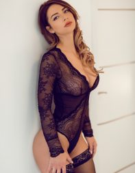 London escort Clover in black lace bodysuit